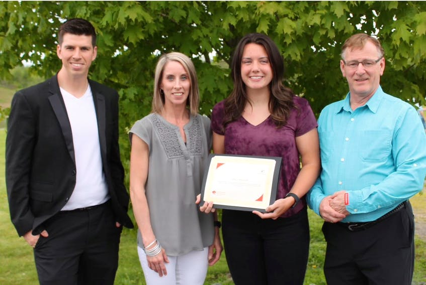 Anna Payson was recently presented with the Ted Rogers Scholarship Fund through Big Brothers Big Sisters of Colchester. Payson, centre, was joined by Nick Sharpe, Big Brothers Big Sisters of Colchester executive director; Shawna Fraser, mentoring co-ordinator; and Gordon Dewolfe, Rogers store manager in Truro.