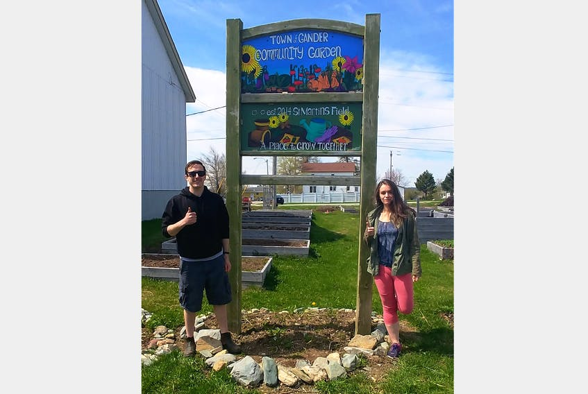 Jordan Lawrence and Melissa Francis are big fans of the community garden. Lawrence is a volunteer and spokesperson for the Gander Community Garden Committee (GCGC). Francis is an artist from Gander Bay who made the new sign for the garden.
