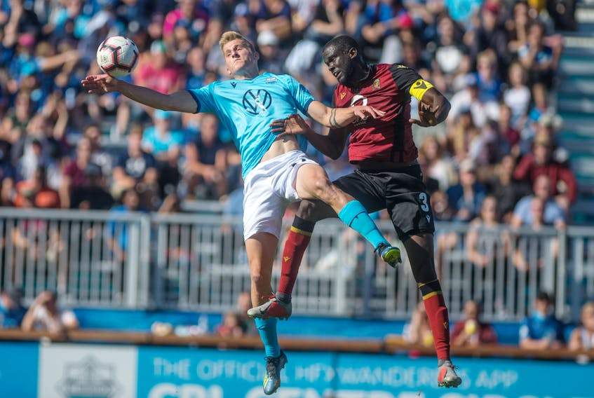 HFX Wanderers striker Tomasz Skublak, left, and Valour FC defender Skylar Thomas vie for the ball during a game last September at the Wanderers Grounds in Halifax.