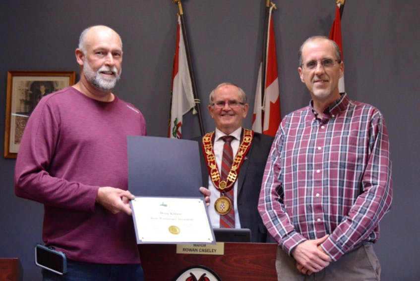 Doug Killam, left, public works manager for the Town of Kensington, shows the certificate of appreciation from the town with Kensington Mayor Rowan Caseley and chief administrative officer Geoff Baker. Killam has completed course work with the Environmental Training Institute.