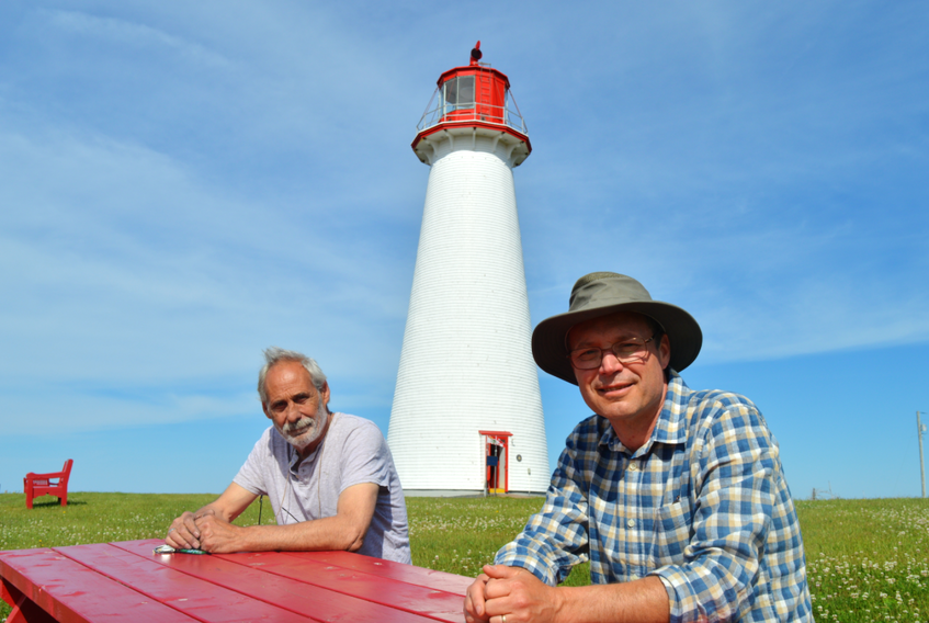 Even though there won't be quite as many tourists around this year, John Krolilkowski, left, maintenance man, and Vic Douse, chairman of the Point Prim Lighthouse Society, helped make sure capital improvements still took place.