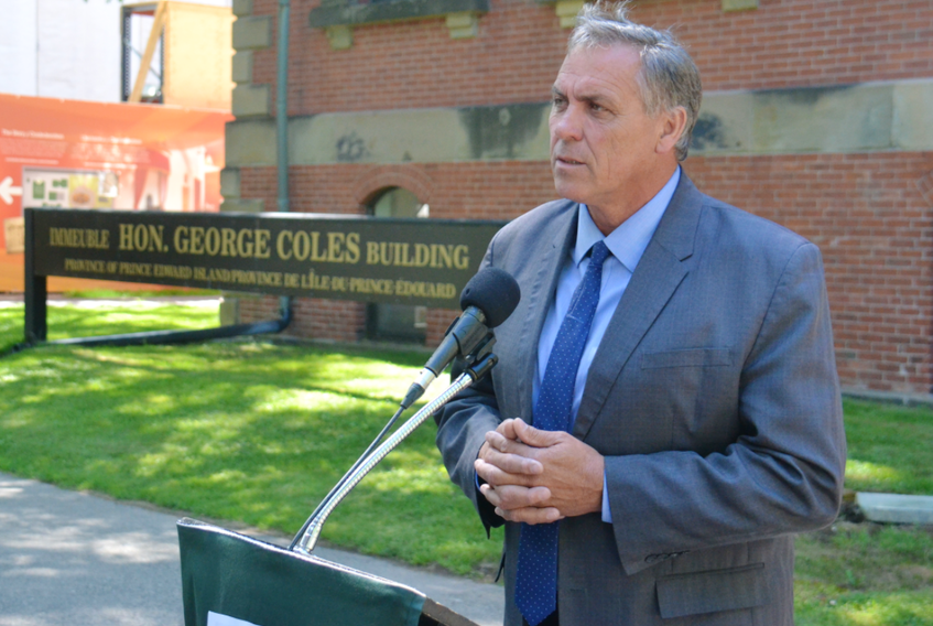 Liberal MLA Robert Mitchell, speaking to media outside the Coles Building on Tuesday, said he believes the recent staff layoffs and program cuts are a sign that funding to Holland College needs to be increased.