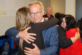 Liberal incumbent Sean Casey hugs a supporter at his election viewing party on Oct. 21. Casey held on to his seat in the Charlottetown riding.