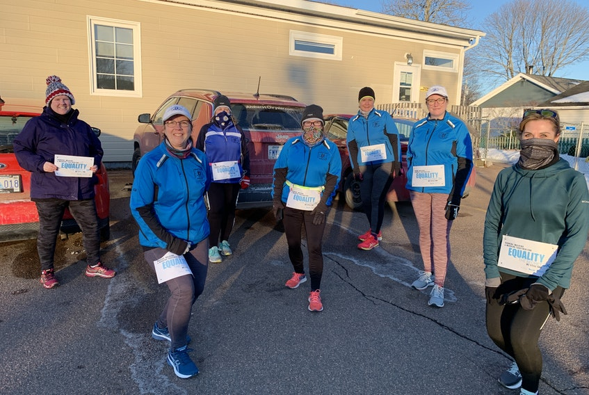 Amherst Striders (from left) Shawn Doucette, Kim Ford, Linda Carter, Karen Morehouse, Jennifer Furlong, Laura Roy and Rae Burke prepare to hit the streets of Amherst on Wednesday night to participate in The Secret 3K to celebrate gender equality and safe and inclusive spaces. The run, held around the world, was inspired by the 2015 Marathon of Afghanistan and the situation faced by women in some countries who are unable to run or walk in public.