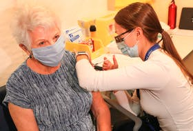 Bernice Brown, 82, of Halifax, receives her vaccine from Allison Milley, RN at the IWK Health Centre. Bernice is the first senior in Nova Scotia to receive her vaccine in a community-based vaccination clinic.