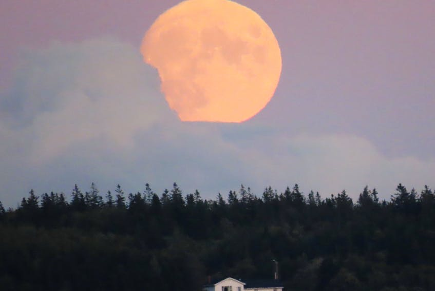 """A mostly cloudy day gave way to a pleasant evening surprise in North Sydney NS.  Judy LeBlanc-Brennan was pleased to see the """"almost"""" full moon appear low on the horizon Monday night.  The Full Corn moon was officially full at 2:22 a.m. ADT/2:52 a.m. NDT this morning."""