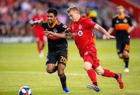 Toronto FC attacker Jacob Shaffelburg, right, battles for the ball against Houston Dynamo defender A. J. DeLaGarza during a July 20 MLS game at BMO Field. Kevin Sousa/USA TODAY Sports