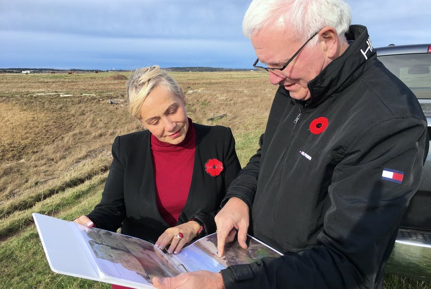 Bill Casey and Cumberland-Colchester MP-elect Lenore Zann look over cut stones that are remnants of the Chignecto Marine Ship Railway in Fort Lawrence. The working and stones have been left as they were when the project collapsed in 1890, but now they are falling into the Bay of Fundy.