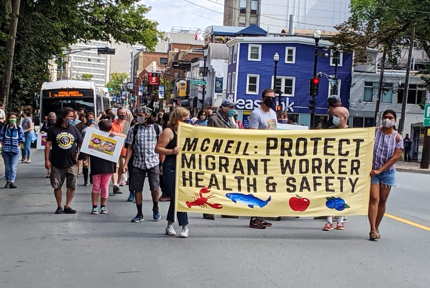 Demonstrators march in a Fight for $15 and Fairness rally on Labour Day, 2020. - Tim Krochak