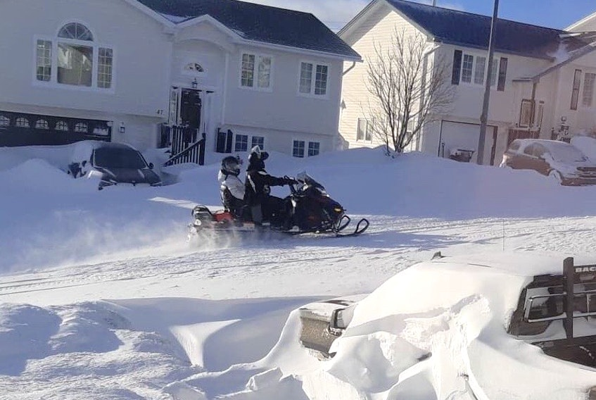 Many residents in the St. John's metro area are taking to the streets during this statement of emergency on snowmobiles, as these riders in Paradise did Saturday, but police are urging people not to do that, as municipalities try to clean up from record-breaking snowfalls.
