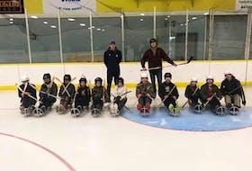SMECA Grade 7 students ready to learn about and enjoy sledge hockey from Bulldogs sledge hockey program instructors.