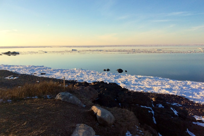 """Marie MacDonald sent this lovely photo of the Northumberland Strait at dusk in the village of Arisaig. She wrote: """"Our home is on a peninsula and we have the ocean on three sides.  We look forward to ice breakup every year.  This year in particular, the ice receding and coming back to shore has been very early.  Let's hope the fishers can bring us our lobsters early as well."""" Thank you for the photo!"""