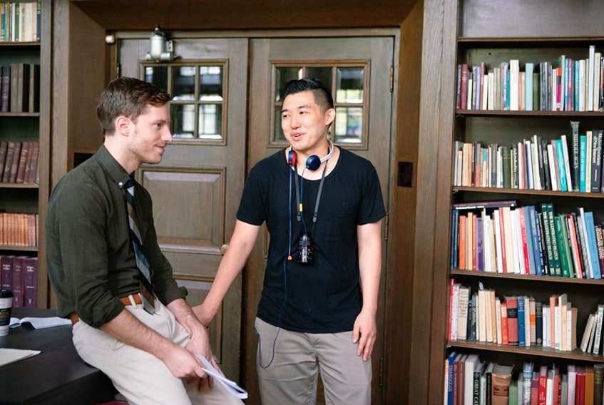 Stealing School director Li Dong consults with actor Jonathan Keltz between takes. A student at Dalhousie Law School in the 2000s, Dong's film premieres on iTunes and AppleTV on June 23. - Game Theory Films