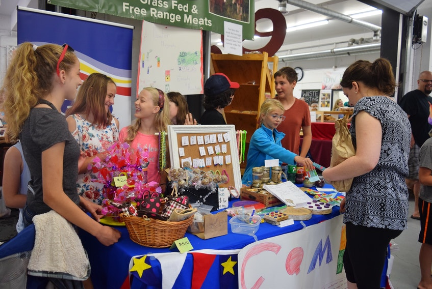 These École Acadienne de Truro students enjoyed a brisk trade at the Truro Farmers Market on Saturday, selling everything from fridge monster magnets to Tic Tac Toe wood products. To break even, the students must make at least $30, to repay the money loaned them to buy supplies.