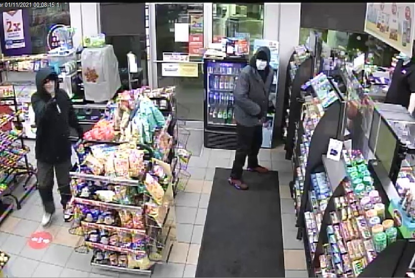 This still taken from security camera video shows the two suspects in an armed robbery at a St. John's service station Monday.