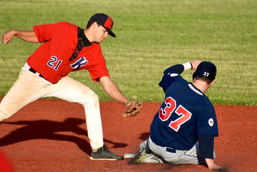 Walker O'Connor of the Sydney Sooners, right, slides safely into second base as Zack Zinck of the Kentville Wildcats prepares to slap the tag during Nova Scotia Senior Baseball League action at the Susan McEachern Memorial Ball Park on Friday.