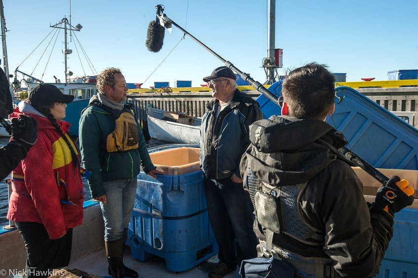 Boris Worm, second from the left, films for Ocean School on Fogo Island. Worm co-authored a recently published report on the future global fish stocks.- Nick Hawkins
