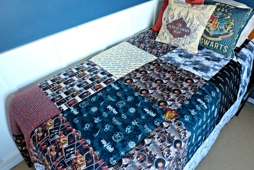 Heather sewed her son a gigantic Harry Potter quilt from 13 different fabrics.