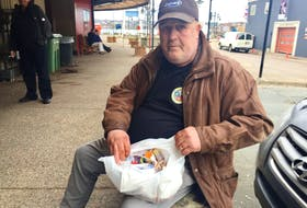 Raymond Marshall shows the many medications he's taking while living homeless in Halifax.