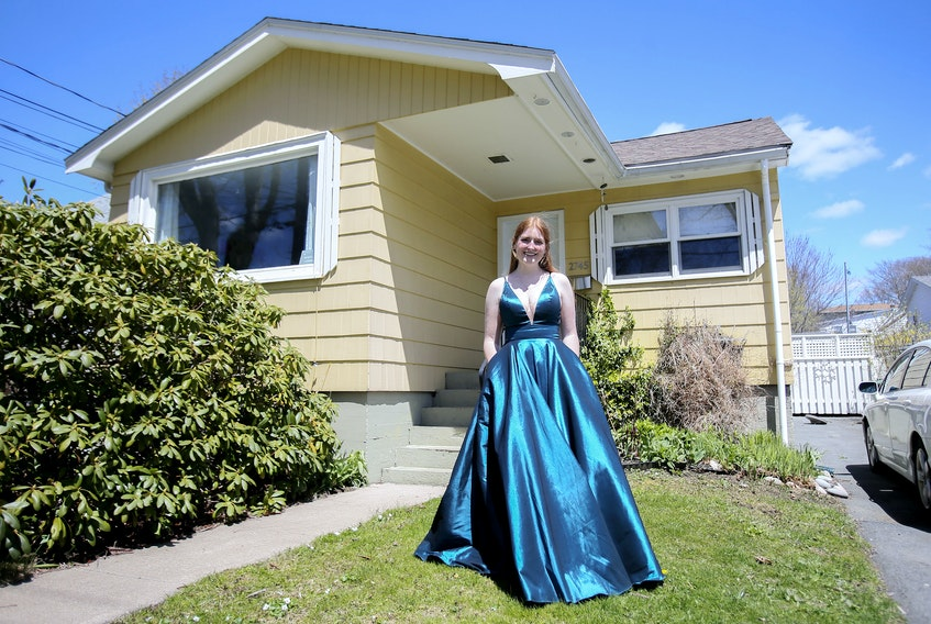 Bridget Gillespie, a Citadel High School grad, is seen in her prom dress at her Halifax home Thursday May 14, 2020. Gillespie is helping to organize a virtual prom.