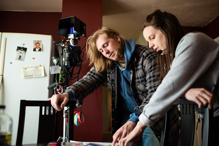 Bone Cage director and star Taylor Olson goes over a scene with producer Melani Wood on the set of the Nova Scotia-shot feature which debuts locally via FIN Stream online film festival, starting Thursday.
