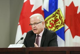 Justice Minister Mark Furey answers a question after an announcement on Thursday, July 23, 2020, of a joint independent review into the mass shooting on April 18 and 19.