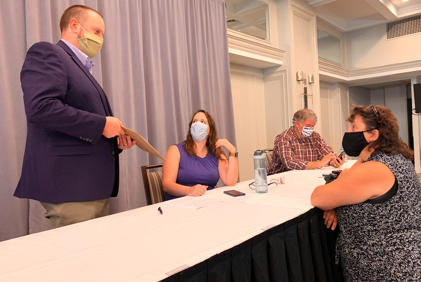 From left to right: Paul Wozney, NSTU president, chats with Nova Scotia Parents for Public Education members Christine Emberley, Adam Davies and Stacey Rudderham at a news conference in Halifax on Thursday, Aug. 27, 2020.