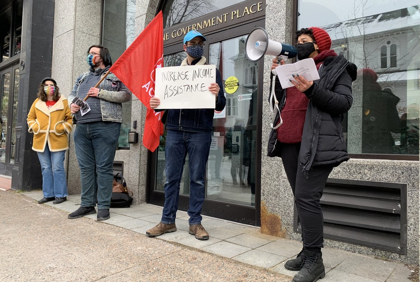 About a dozen people rallied in front of One Government Place on Barrington Street in Halifax on Saturday, Jan. 30, 2021, demanding action from the soon-to-be new Nova Scotia Liberal on the housing crisis.