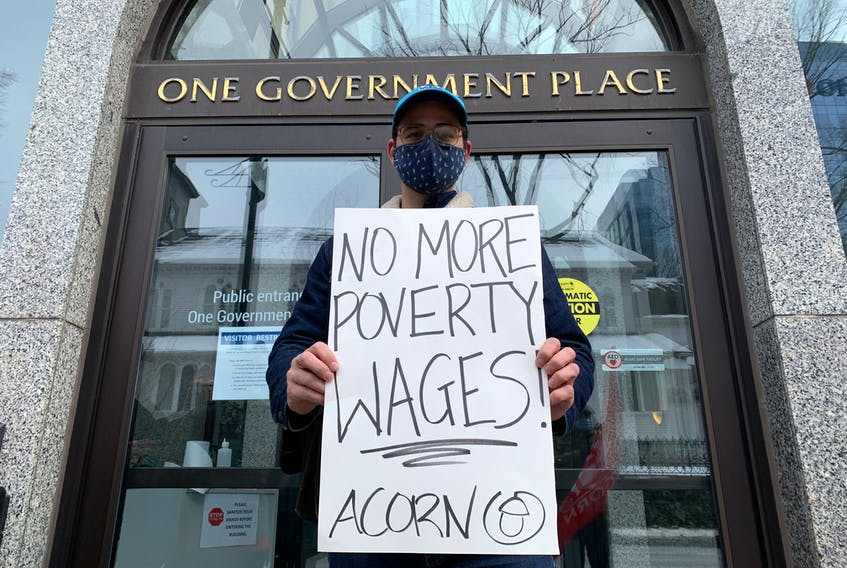 Jacob Wilson stands in front of One Government Place on Barrington Street in Halifax, N.S., on Saturday, Jan. 30, 2021. Wilson was one of a dozen people to rally in front of the government building to call on the soon-to-be new Liberal leader to act on the housing crisis.