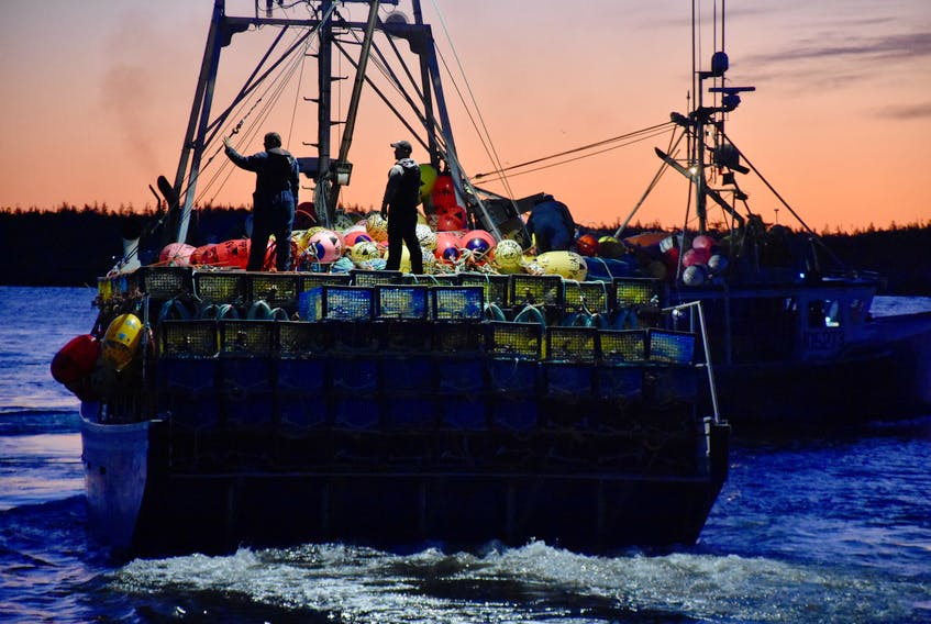 Lobster vessels head out to the lobster fishing grounds to set their gear on the dumping day in southwestern Nova Scotia.