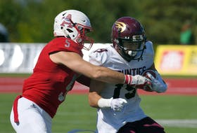 Acadia linebacker Bailey Feltmate tackles Mount Allison's Drew Besco in a recent Atlantic university football game at Wolfville. Peter Oleskevich / ACADIA ATHLETICS