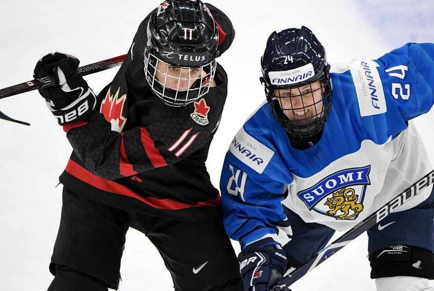 Canada's Jill Saulnier, left, battles Finland's Noora Tulus during semifinal action at the 2019 world women's hockey championship in Espoo, Finland. On Saturday, her  28th birthday, Saulnier learned of the news that this year's worlds to be held in Halifax and Truro had been cancelled.