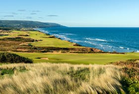 A view over the 12th green with the 18th hole in the background at Cabot Cliffs.  Evan Schiller Photography