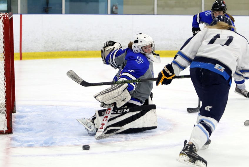 Feb. 2, 2021--Lockview Dragons' Kaitlyn Langille makes a pad save as she reads the play as C.P. Allen attacks late in the second period at the BMO Centre Monday. ERIC WYNNE/Chronicle Herald