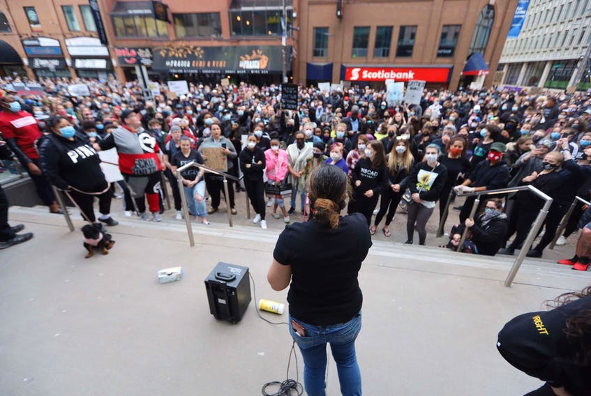 Thousands of participants listen to Sharisha Benedict speak at an event along Spring Garden Road in Halifax Monday night, June 1, 2020. The event was held in solidarity to peaceful rallies held in the United States protesting the death of George Floyd last week by a Minneapolis police officer who knelt on the man's neck.