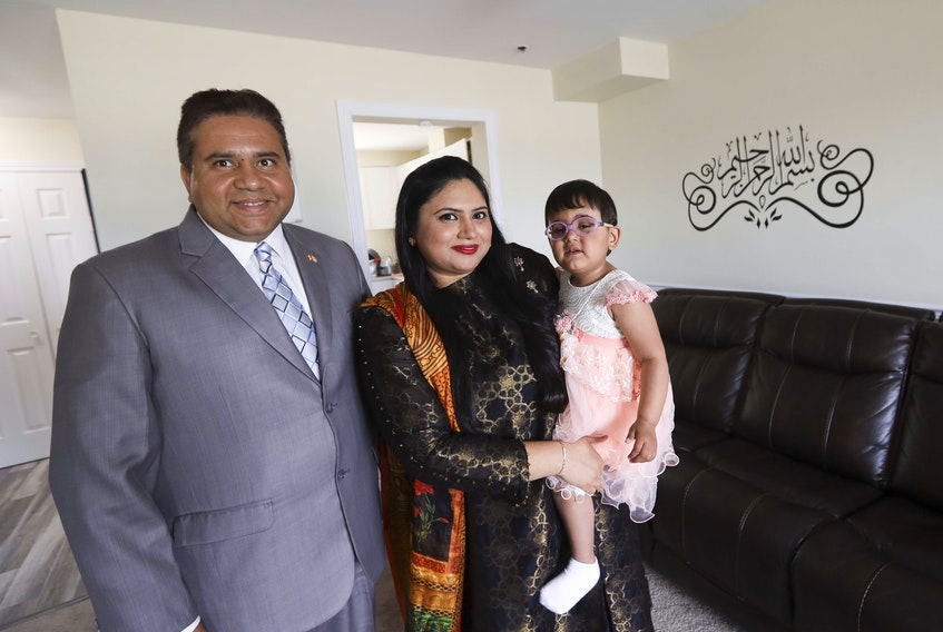 New Canadians Muhammad Ahmad, left, his wife Shumaila Jamil and daughter Aminah Ahman, 2 1/2. The Halifax family took part in a virtual citizenship ceremony.