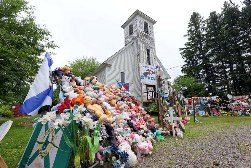 Items of condolence overflow on the steps and yard in front of the old Portapique Church on Thursday, July 23, 2020.