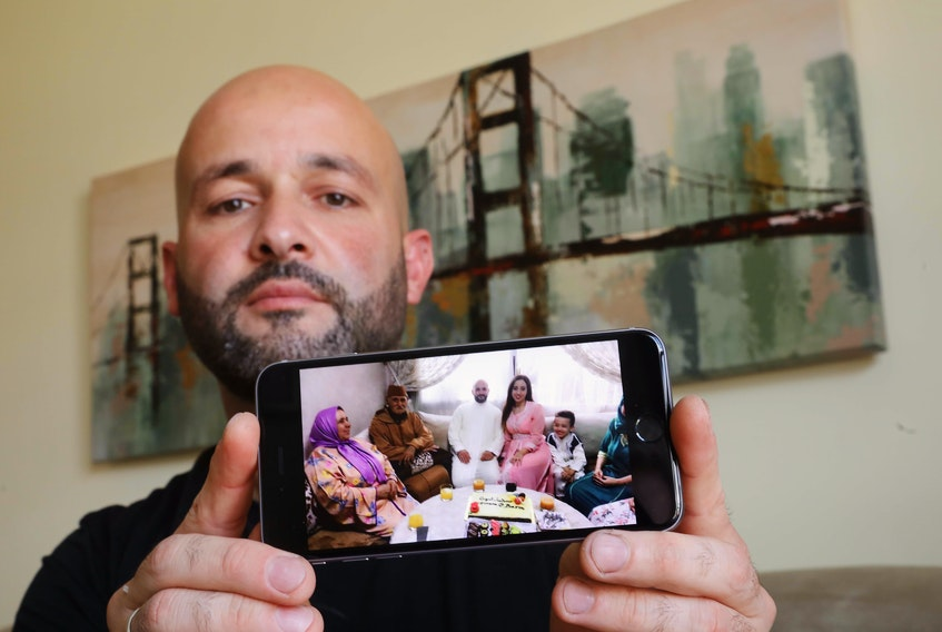 July 24, 2020—Baris Bayraktar shows a photo of his new wife and her family in Morocco after they were married in 2019. Bayraktar has been trying to sponsor his wife to come to Canada, but has been caught up in government red tape aggravated by delays due to COVID-19.