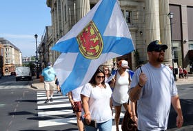 Nick Beaton, Kristen Beaton's husband, and the families of the Nova Scotia mass shooting in April hold a march of thanks Wednesday, July 29, 2020, after public inquiry called.