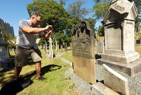 Cemetery explorer Craig Ferguson takes a photo of an ornate gravestone at Holy Cross Cemetery on South and South Park Streets in Halifax for an entry on his @deadinHalifax Twitter account. For the past year, the journalist and TV producer has been sharing stories and sights found in graveyards around the province. - ERIC WYNNE/Chronicle Herald