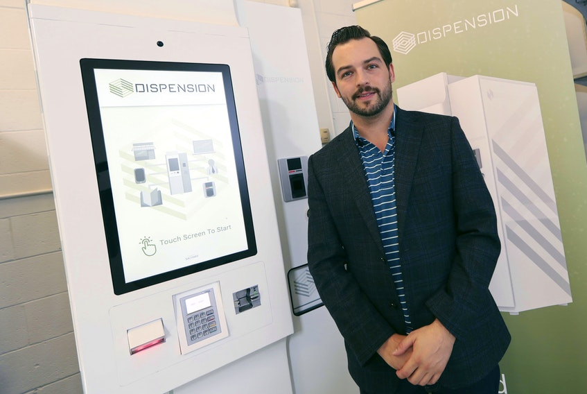 Corey Yantha, CEO of Dispension Industries in Burnside, stands beside a kiosk that dispenses controlled substances using palm-identification technology for safety and security.  ERIC WYNNE/Chronicle Herald