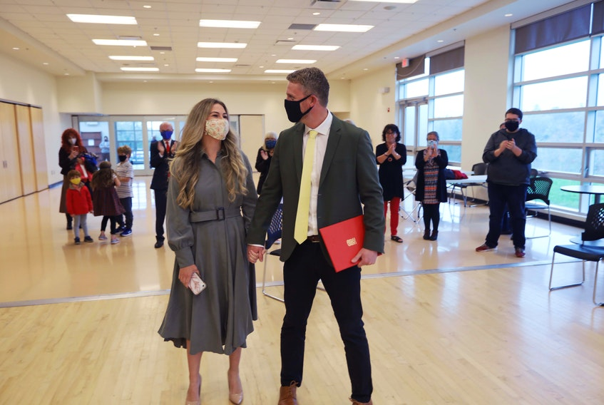 Iain Rankin and his wife Mary Chisholm walk into the room at the Prospect Road Community Centre on Monday, Oct. 5, 2020. He officially put his hat in the Liberal leadership race to replace outgoing leader Stephen McNeil.