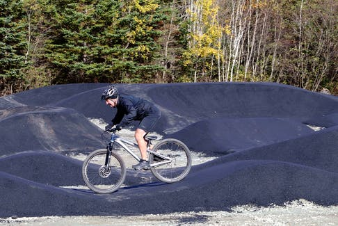 Oct. 28, 2020—Halifax District 6 Councillor Tony Mancini goes over the undulating bumps and hills the new Shubie Park Pump Track Wednesday morning. Adam Shore, owner of Shoreline Dirtworks, the company that designed the track, said there is a 'tremendous culture around skateboarding in Halifax', mainly because of the skatepark in the Halifax Common. 'This (provides a cross over exercise) into skiing and every other sport'. The track idea was germinated by volunteers and District 6 Councillor Tony Mancini last year. After a process of looking at locations, the group decided on the one next to the baseball field at Shubie Park. 'I really hope that the community embraces this park', said Shore. And to work with other communities in the future and help them realize these things can happen. There's athletes and active people waiting for new things to do. They are going to have a lot of fun.' ERIC WYNNE/Chronicle Herald