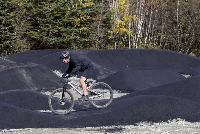 Oct. 28, 2020—Halifax District 6 Councillor Tony Mancini goes over the undulating bumps and hills the new Shubie Park Pump Track Wednesday morning. Adam Shore, owner of Shoreline Dirtworks, the company that designed the track, said there is a 'tremendous culture around skateboarding in Halifax', mainly because of the skatepark in the Halifax Common. 'This (provides a cross over exercise) into skiing and every other sport'. The track idea was germinated by volunteers and District 6 Councillor Tony Mancini last year. After a process of looking at locations, the group decided on the one next to the baseball field at Shubie Park. 'I really hope that the community embraces this park', said Shore. And to work with other communities in the future and help them realize these things can happen. There's athletes and active people waiting for new things to do. They are going to have a lot of fun.' ERIC WYNNE/Chronicle Herald - Eric Wynne