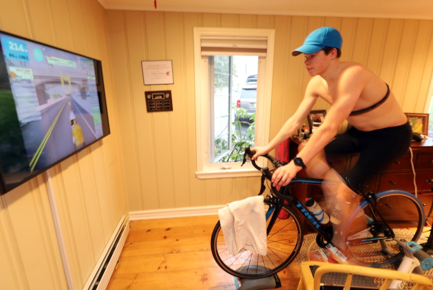 Dec. 13, 2020—Callum Myers, 17, at his home in Dartmouth as he participates in a virtual bike race to race money for Feed Nova Scotia. The ride was done through ZWIFT an online portal so other rides can join from any location in the world. ERIC WYNNE/Chronicle Herald