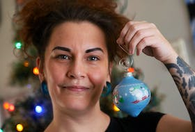 Dec. 14, 2020—Eliese MacKinnon holds up one of her favourite Christmas ornaments as she starts to decorate the tree at her mother's Monday. MacKinnon says COVID has exacerbated her pre-existing mental health conditions. ERIC WYNNE/Chronicle Herald