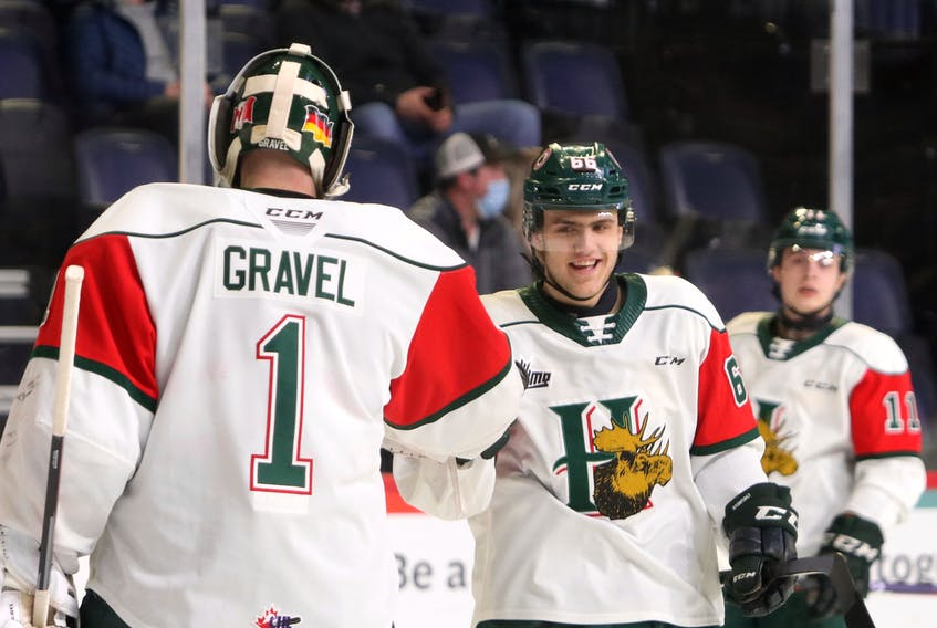 Mooseheads' Zachary L'Heureux jubilates with goaltender Alex Gravel after scoring early agains the visiting Cape Breton Screaming Eagles Saturday.