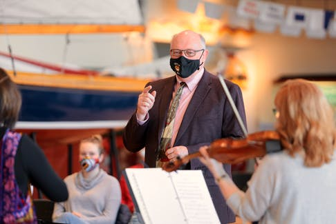 Dr. Robert Strang, chief medical officer of health for Nova Scotia, guest conducts a quintet from Symphony Nova Scotia on Saturday afternoon. The performance at the Maritime Museum of the Atlantic Saturday afternoon. - Eric Wynne