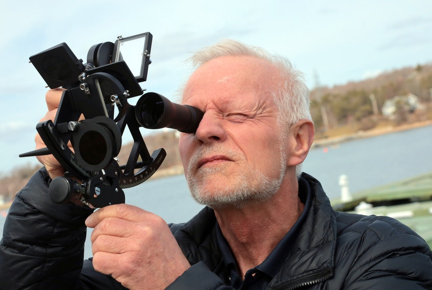 Edward Walentynowicz demonstrates a sextant he will be using to navigate the world's oceans in the Golden Globe Race. (for Chris Lambie story).