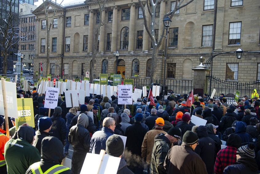 Hundreds of forestry workers and supporters are gather for a rally outside of Province House on Thursday, Dec. 19, 2019. Northern Pulp says it will shut down its Pictou Country mill if the government doesn't extend the Boat Harbour Act deadline.
